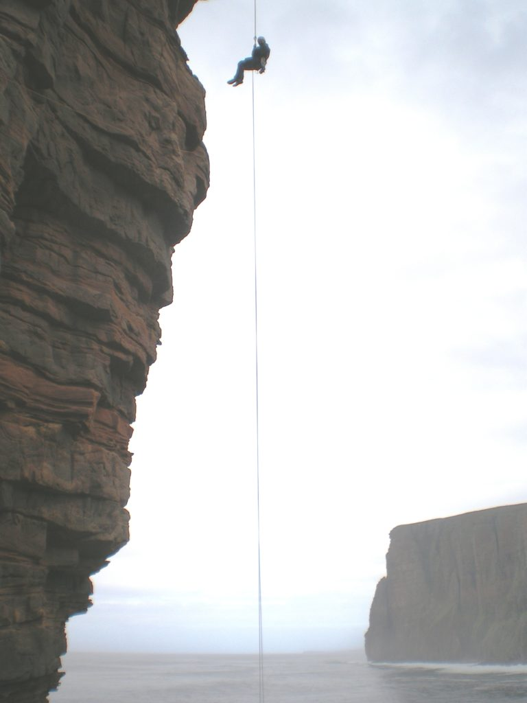 Stuart abseiling off the Old Man of Hoy