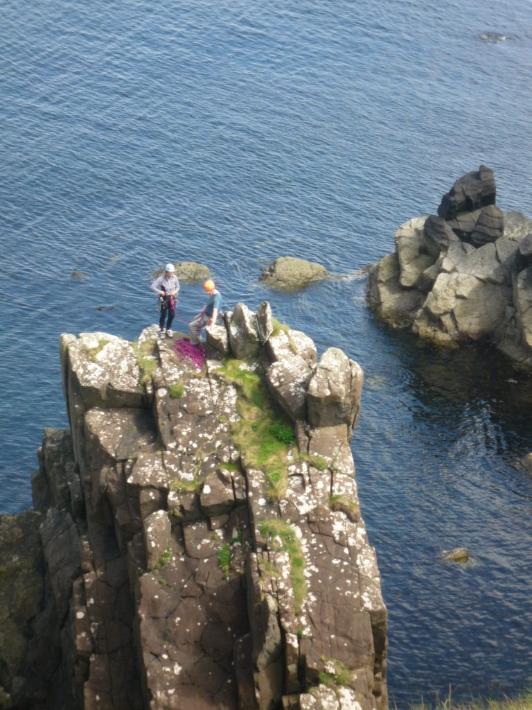 Mark climbing on the Skye sea cliffs