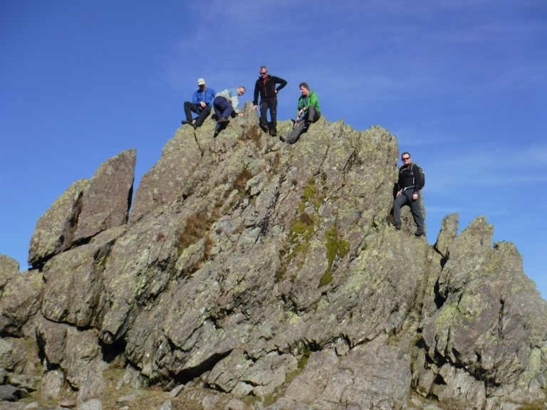 "Club members on the ""Howitzer"" Helm Crag (Winter Scramble)"