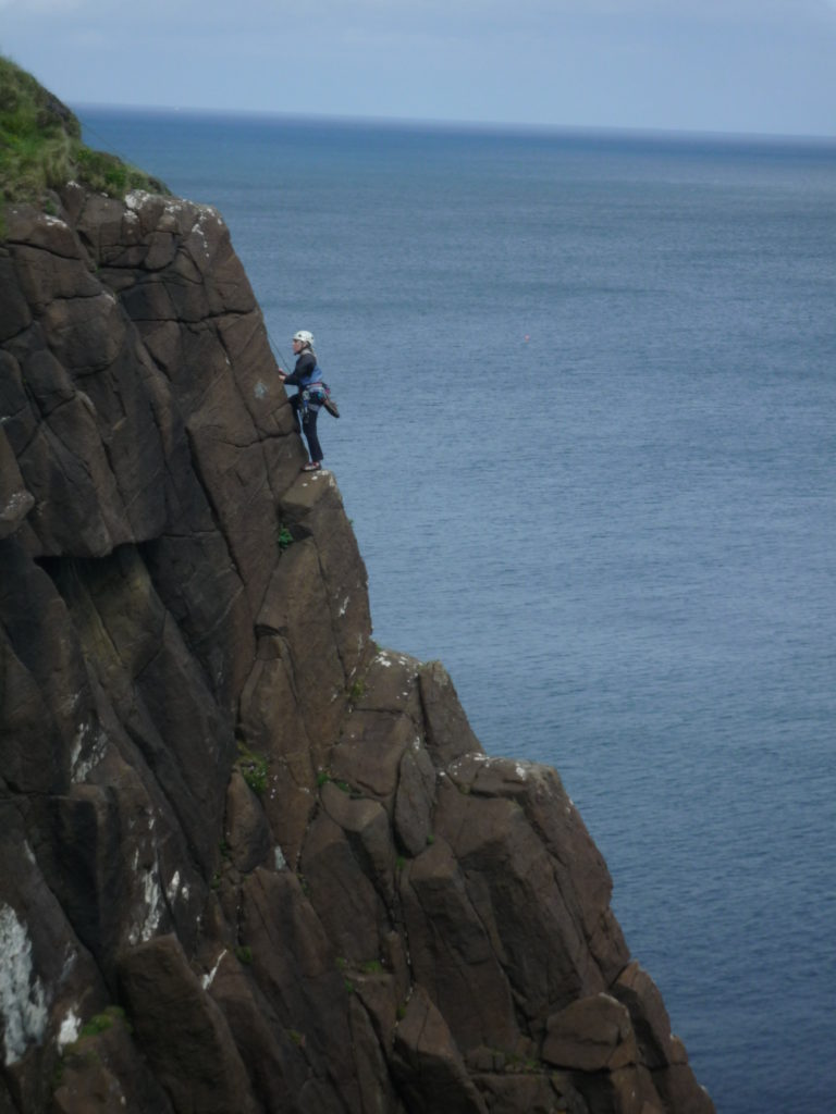 Stuart climbing on the sea cliffs of the Isle of Skye