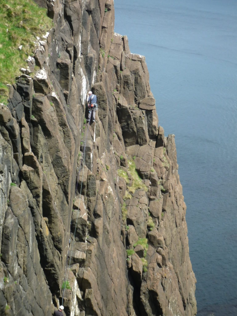Martin climbing on the sea cliffs of Skye